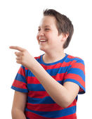 Teenage boy (Causian) waist up portrait, pointing sideways — Stock Photo