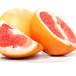Grapefruit, pieces cut apart, isolated on white — Stock Photo