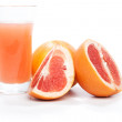 Grapefruit pieces and juice in a glass, isolated on white — Stock Photo