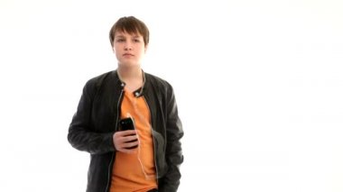 Teenage boy in leather jacket listening to music — Stock Video