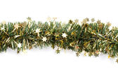 Artificial fir branch garland with tinsel — Stock Photo