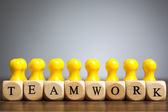 Toy pawn figure concept: Strength, success through teamwork — Stock Photo