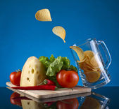 Beer mug and chips — Stock Photo