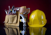Tool belt and helmet — Stock Photo