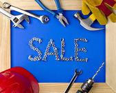 Nástroje a helmu dřevěný rám a prodej — Stock fotografie