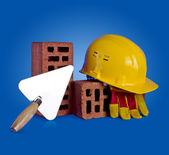 Bricks, trowel and helmet — Stock Photo