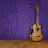Vintage guitar on grunge background texture — Photo