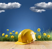 Construction helmet on blue nature background — Stock Photo