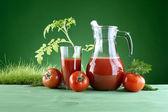 Fresh tomato juice on a background of nature — Stock Photo