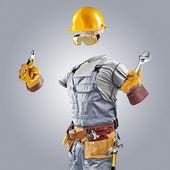 Construtor invisível com alicates e chave inglesa — Fotografia Stock
