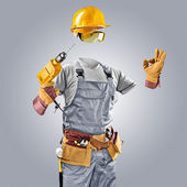 Invisible worker in helmet with drill — Stok fotoğraf