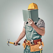 Construction worker with a tool belt and book — Stock Photo