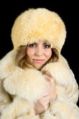 Portrait of a beautiful girl in coat and hat — ストック写真