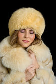 Portrait of a beautiful girl in coat and hat — Stock fotografie