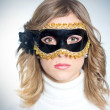 Beautiful girl in the masquerade mask — Stockfoto