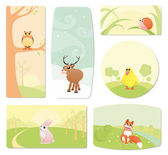 Baby labels of cartoon animals with happy smiles — Stock Vector