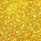 Golden abstrakt mit gold schimmernden bokeh muster — Stockfoto