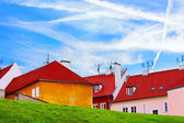 Bright photo of buildings in Czech. Old houses with red roofs on a hill — Stock Photo
