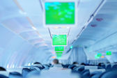 Airplane (aircraft or plane) interior with screens — Stock Photo