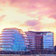 Modern buildings in London at purple sunset — Stock Photo #21323145