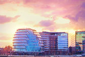 Modern buildings in London at purple sunset — Stock Photo