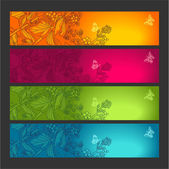 4 floral banners with butterflies — Stock Vector