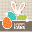 Stock Vector: Greeting card. Easter bunny with colored eggs