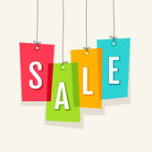 Sale tag on colored hanging labels — Stock vektor