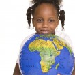 Little girl hugs the globe — Stock Photo