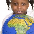 Little girl and globe - Stock Photo