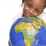 Cute girl holding the globe — Stock Photo