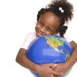 Pretty little girl hugs the globe — Stock Photo