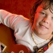 Child rock star plays electric guitar - Stockfoto