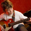 Stock Photo: Child rock star plays electric guitar