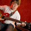 Foto Stock: Child rock star plays electric guitar