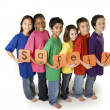 Multicultural children holding neon safety letters — Stock Photo