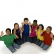 Diverse children sit in semicircle  — Stock Photo
