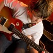 Boy plays electric guitar — Stock Photo