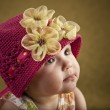 Closeup of a cute baby girl wearing pink hat — Stock Photo #21359451