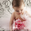 Foto Stock: Small baby girl sitting up wearing frilly tutu