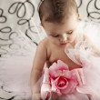 图库照片: Small baby girl sitting up wearing frilly tutu