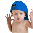 Surprised baby boy in blue ball cap — Stock Photo