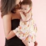 Tender mother hugging her baby daughter — Stock Photo