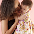 Mother hugging and kissing her daughter  — Stock Photo
