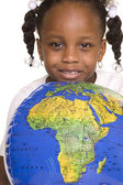 Little girl and globe — Stock Photo