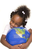 Pretty girl hugging the globe — Stock Photo