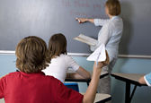 Mischievous students in the classroom — Stock Photo