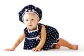 Caucasian toddler girl sitting on floor in dress — Stock Photo