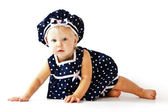 Caucasian toddler girl sitting on floor in dress — Stock Photo