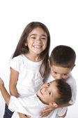 Smiling hispanic siblings hugging — Stock Photo